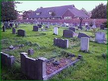 Sutton on Hull churchyard - looking towards the NW wall and the Church Hall . . click for a larger and clearer image of Pat Hughes' grave inscription.