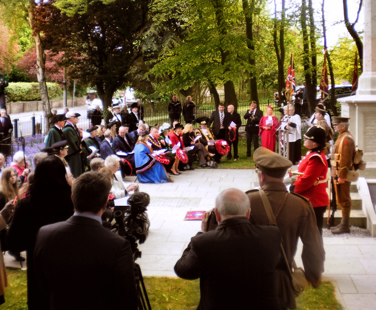 The dedication service at the unveiling of the paver